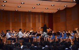 Performance by Wind Band and Senior Mixed-voice Choir