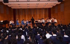 Performance by String Orchestra and Harmonica Orchestra
